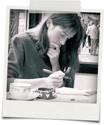Woman grading papers in a cafe