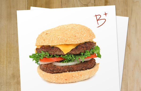 A hamburger on a piece of paper with a B+ grade