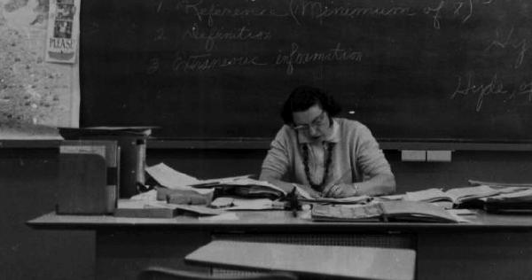 Teacher working at a desk