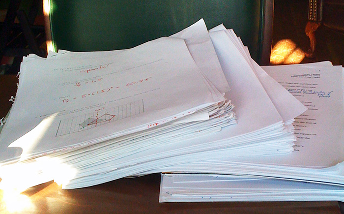 Pile of student papers on a desk