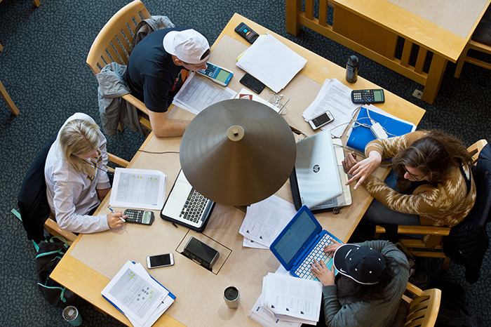 Students working at a desk in the library