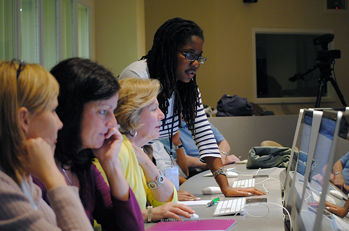Women learning in front of computers