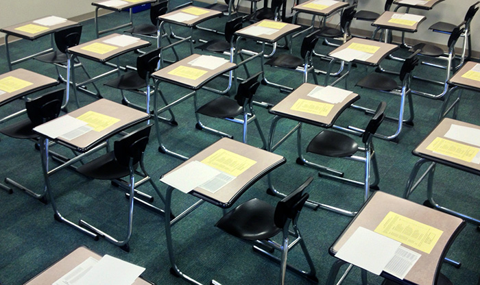 Classroom with exam booklets on tables