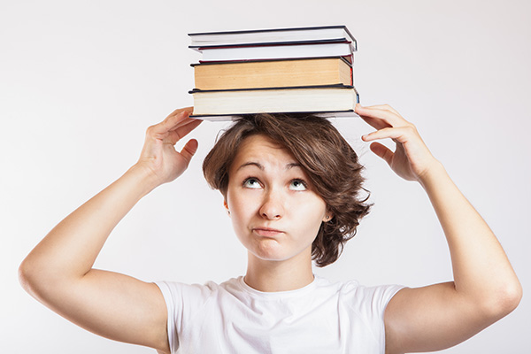 Student balancing books